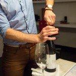 Opening a fine bottle of Italian wine